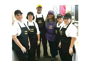Chef Carolyn Silas-Sams and Staff Posing for a Picture at Carolyn's Creole Kitchen
