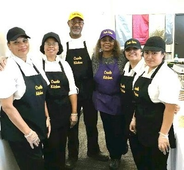 Carolyn Silas-Sams and Staff Posing for a Picture at Carolyn's Creole Kitchen